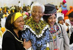 Former South African President Nelson Mandela celebrates his birthday with his wife Graca Machel ( L ) and ex -wife Winnie Madikizela M.