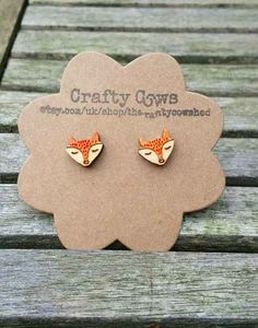 31 Foxy Additions To Your Spring Wadrobe wooden sleeping fox earrings.