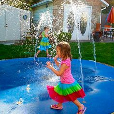 This home backyard spray park is the perfect size. They have fiber optics nozzles, so at night they run it just for the ambiance and to hear the water running.