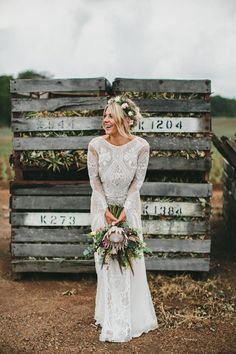 bohemian lace wedding dress and protea wedding bouquet