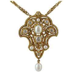 Art Nouveau Pearl Diamond Gold Open Work Pendant. 18 karat yellow gold Art Nouveau open work pendant set with Old European cut diamonds and seed pearl accents. c 1890-1900