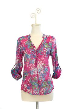 """Dressing Your Truth - Type 1 Fresh Floral Top - Add some fun floral to your wardrobe with this fun cotton top. The button closure extends half way down the front allowing you to dress even faster with only half the buttons to do up. A great spring to summer transition top. 100% Cotton 3/4 Length, Roll-Tab Sleeve Button Closure 26"""" length from top of shoulder (measurement taken from size small)"""