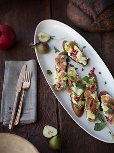 Ricotta, Shaved Squash, prosciutto + pomegranate crostini