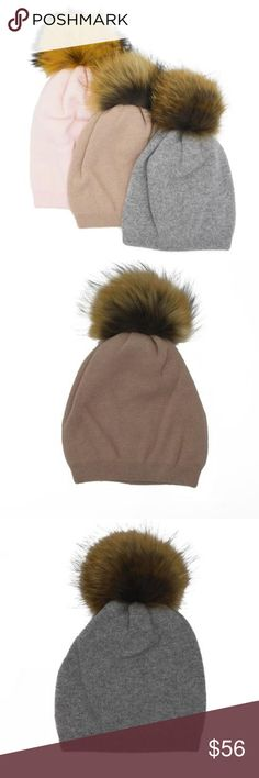 Cashmere Hat with Raccoon Fur Poms Stay warm in style with this soft cashmere hat topped with a Genuine Raccoon Fur Pom Pom.  100% Cashmere Genuine Raccoon Fur Made in China Accessories Hats