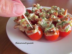 BLT Bites  16 cherry tomatoes  1/2 pound apple-smoked bacon, cooked and crumbled  1/2 cup mayonnaise (not Miracle Whip)  1/3 cup minced green onions, white and green parts  2 tbsp. minced romaine lettuce