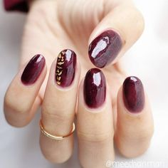 Abstract red wine burgundy nails with gold leaf detail