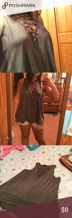 Gray cut out tank Never worn, I didn't have the guts(or chest) to wear it but the right person will make it SUPER cute! It's in great condition and the material is really comfortable. It's also a little big for a medium so it would work for medium or large Rock & Republic Tops Tank Tops