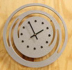 modern metal art clock... like the cutouts as a rosette design