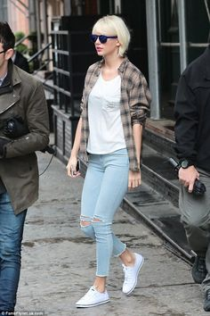 Out and about: The 26-year-old singer is normally seen in dresses but mixed it up in tight jeans and a t-shirt for the outing