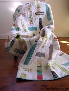 Monica's Lawn chair quilt pattern Moda Bake shop.  Sometimes simple is perfect--love the modern colors/fabric patterns in simple shapes against a lot of pure white ground with heavy quilted texture.