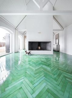 UNIQUE: Floor tiles that resemble hardwood flooring in a herringbone pattern, handcrafted from green lava stone.