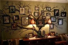 From Kimbearly Originals; this.    They started with an olive painted wall. Added tree in dark brown. Leaves in sage-y olive color. Top with framed photos of ancestors and family now. So beautiful.