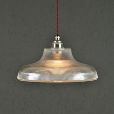 This prismatic glass lamp is modelled on a vintage railway lamp.Flex Colour: Choose for your light to be wired with any of our 9 different colour braided cables. <strong>Ceiling Rose: </strong>Our Domestic rose is a nickel plated strapped cup with room to connect your existing wires to your new light. It has a diameter of 10cm and depth of 6cm. Our Industrial plate is a nickel plated Besa cap and is designed to work with standard conduit. Its diameter is 6cm. Bulb not included (E27 screw…