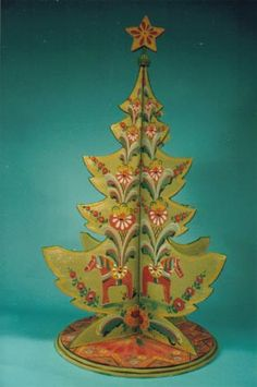 Christmas Tree: this one is Scandinavian design but could easily be transformed into Irish symbols for and Irish Christmas tree.  Look at craft stores for basal wood kits. You can probably pick up some basal wood ornaments as well and convert  them too!