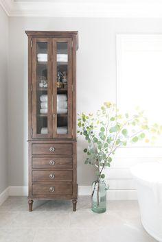 PURE SALT INTERIORS // TALEGA BEACH HOUSE PROJECT // MASTER BATHROOM // vintage wooden bookcase, eucalyptus, glass vase, marble, subway tile, freestanding tub..