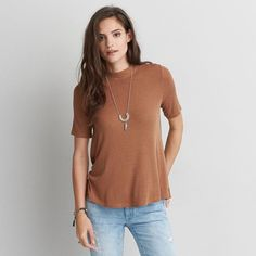 AE Soft & Sexy Swing T-Shirt ($35) ❤ liked on Polyvore featuring tops, t-shirts, brown, half sleeve tee, sexy tops, elbow sleeve tee, sexy tee and ribbed tee