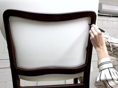 Removing the caning and upholstering a dining room chair tutorial.