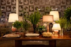 Composition of lamps and green plants arragements