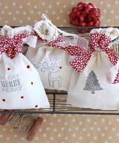The Best DIY Gift Wrap Ideas Ever - Such a cute idea for Christmas gifts! All you need are fabric bags, stamps and an adorable ribbon or fabric strip for the bow.