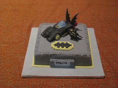 Lego Batman Cake - This is my first cake- not only baking from scratch but also I had never used fondant before. It's vanilla sponge cake with butter cream, and fondant. The car is sculpted from cake, and all the decorations are fondant. I painted the details using food coloring. Thanks for any suggestions as I'm very new at this.