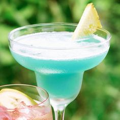 Blue Hawaii   (1 oz. Light Rum  1 oz Blue Curacao  2 oz Pineapple Juice  1 oz Cream of Coconut)