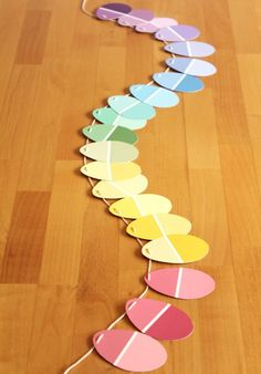 Easter Garland, using paint chips - great, colourful idea for any occasion (just change the shapes!)