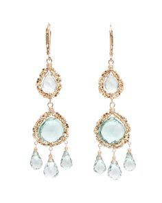 "Dana Kellin Gold Cluster Aqua Quartz Chandelier Earrings 	Chandelier drop earrings featuring pale blue aqua quartz framed by clustered gold beads  	14k yellow gold fill 	Handcrafted wire wrap detail  	2.625""L total drop  	0.625"" at widest point  	Lever backs 	Made in Los Angeles"