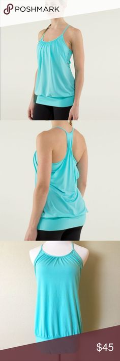 LULULEMON No Limits Tank Angel Blue Stripe Like a sunny Saturday afternoon at Vancouver's Wreck Beach, this tank is all about exploring our limits.   To create this loose-fitting, light and airy tank we used a combination of luon in the bra and Circle Mesh in the core to optimize its movement and breathability. It's the perfect match for our Vinyasa practice where we like our clothes to mimic and accentuate our flow.  Size 6, size dot confirmed. Pads not included. Gently worn, no flaws…