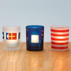 Amazing Deal!!  88% OFF!!!  Orig. $24.95 now ONLY $3.00!!! Add a dose of seaside style to your room with our frosted glass votive cups.  The nautical flag design represents PartyLite®!