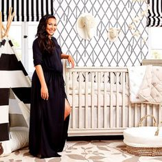 With charcoal-and-white wallpaper and striped Roman shades, actress Naya Rivera chose strong graphic patterns and a neutral palette for her first baby's nursery. Whimsical touches, such as a black-and-white striped teepee and adorable animal accent pieces, keep the room kid-friendly and playful. (via Parents.com) #celebrity #baby #nursery