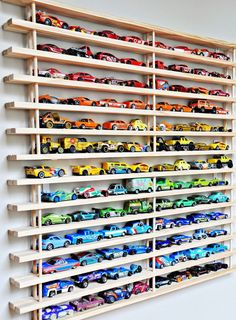 "Do you find matchbox cars hidden in every nook and cranny of your house? Keep each one readily accessible (and organized!) with this wall-mounted ""garage."""