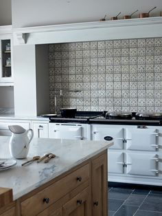 Beautiful Bastide Kitchen in Bone White with the gorgeous handmade Marrakech Sofia Tiles.