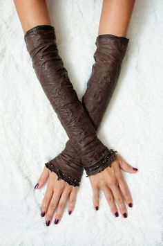 Leather sleeves or fingerless gloves also known as Kittys. $174.00, via Etsy.
