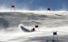 Marion Bertrand has to contend with gusting winds as she speeds down the course during an alpine ski, women's World Cup giant slalom Photograph: Giovanni Auletta/AP