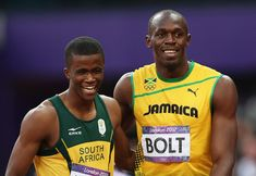 Usain Bolt, Anaso Jobodwana - (L-R)Anaso Jobodwana of South Africa and Usain Bolt of Jamaica smile afte competing in the Men's 200m Semifinals on Day 12 of the London 2012 Olympic Games at Olympic Stadium on August 8, 2012 in London, England.  (August 7, 2012 - Source: Quinn Rooney/Getty Images Europe) - http://www.PaulFDavis.com/success-speaker (info@PaulFDavis.com)