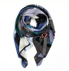 Mapoesie Blue Meli Melo Silk & Wool Scarf: The Meli Melo scarf by Mapoesie is a beautiful mix of fabrics as well as colours. The scarf features both 100% smooth silk and wool/silk mix fabrics in a graphic print.  MaPoésie is a French brand specialising in wool and silk scarves in beautiful colour combinations. Available in wool, superfine silk and wool/silk mixes.