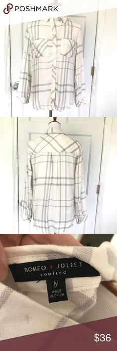 Romeo & Juliet Couture long sleeve flannel Soft and comfortable flannel by Romeo & Juliet Couture. Grey and white plaid. Excellent condition. Size medium. No flaws. Romeo & Juliet Couture Tops Button Down Shirts