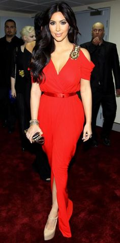 Look of the Day › October 17, 2011 WHAT SHE WORE Kim Kardashian brought the heat to the Dubai Mall with a scarlet column and sky-high pumps. WHY WE LOVE IT The red hot beauty showcased her upper body in an embellished, off-the-shoulder design.