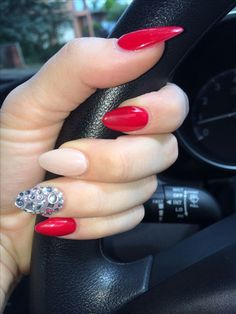 Solid nude with hot red and rhinestones  Stilleto nails! The red is stunning and the diamonds