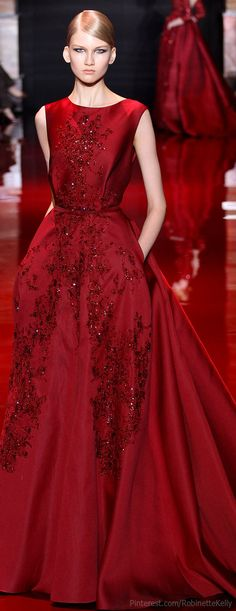 Elie Saab Haute Couture. What a rich, gorgeous, red! Calling all July babies--this fiery red dress is as beautifully hued as your ruby birthstone! ;)