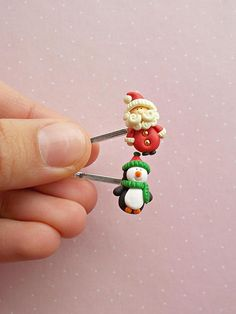 Christmas hair clip set created from polymer clay without molds or forms. The set includes 2 pins, as in pictures: one with Santa Claus, the other one with pinguin. A perfect gift for winter holidays and Secret Santa. The lenght of each charm is 1.6 cm. The lenght of the metallic pin is 5,5