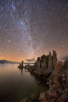 """Startrails above an Alien Lake"" by Grant Kaye (http://grantkaye.com). Stars trails move around the north celestial pole, photographed from the shore of Mono Lake in California. Credit: Grant Kaye. Courtesy of TWAN."