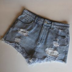 BDG Shorts Super High Rise Cheeky  BDG Shorts Super High Rise Cheeky. Lots of rips, distress. In excellent condition. Size 28 Urban Outfitters Shorts Jean Shorts