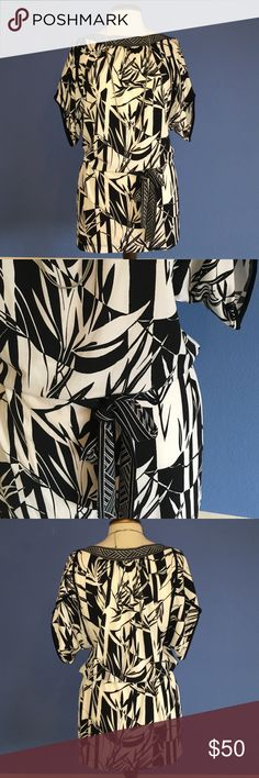 "📍New Listing📍BCBGMaxAzria Black & White Dress This dress is super cute!  The print is similar to leaves. Perfect dress for a vacation or living in Hawaii.  Their is a belt to tie for your perfect fit. Material:  94% Polyester/6% Spandex. Measurements:  Length - 33.5/Bust - 20""/Waist - 19.5"" BCBGMaxAzria Dresses Mini"