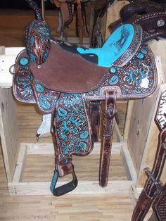 Turquoise & chocolate http://www.horsesandheels.com/2012/01/double-saddlery/