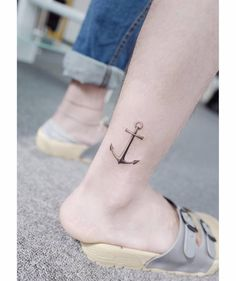 Anchor tattoo on the ankle.