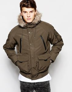 """Parka by Pull&Bear Lightly textured, durable fabric Padded for warmth Faux-fur trimmed hood Concealed zip fastening Press stud placket Raglan sleeves Five external pockets Quilted elbow patches Ribbed hem Regular fit - true to size Machine wash 100% Cotton Our model wears a size Medium and is 188cm/6'2"""" tall"""