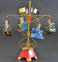 Müller & Kadeder Tin-Carousels Go-round hand painted tin, features four chair lifts with se