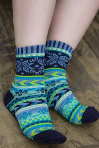 Classic Nordic patterned bands wrap around the sock up to the subtle snowflake motif at the top.