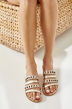 The Polixeni slide sandals are handmade in Athens, Greece of gold supple leather and designed with four straps, two plain and two woven. They set on a lightweight rubber outsole that offers comfort & stability. These flats are such a chic option for the summer, you could wear them with airy skirts on vacation or jeans and relaxed tailoring back home. They are great for elevating summer outfits. Above all, it does not demand a lot of effort to be alluring and make a dazzling appearance. Leather Sandals Flat, Gold Sandals, Strappy Sandals, Slide Sandals, Women Sandals, Summer Shoes, Summer Outfits, Slingback Sandal, Gold Leather
